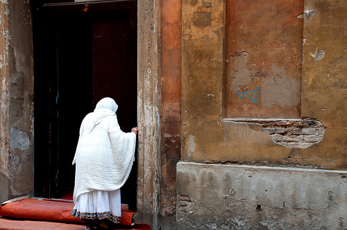 A Muslim woman enters an Orthodox church in Bologna for morning prayers. What I learned: early Sunday mornings make for amazing photographs.